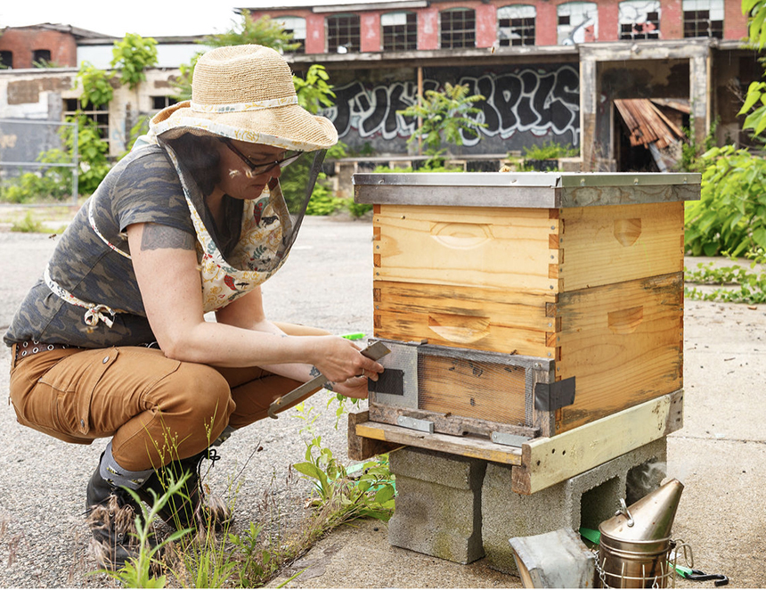 Cindy Holt runs Little Rhody Beekeeping. She manages 34 hives, including three at What Cheer Flower Farm in the Providence neighborhood of Olneyville. (Rue Sakayama photos)