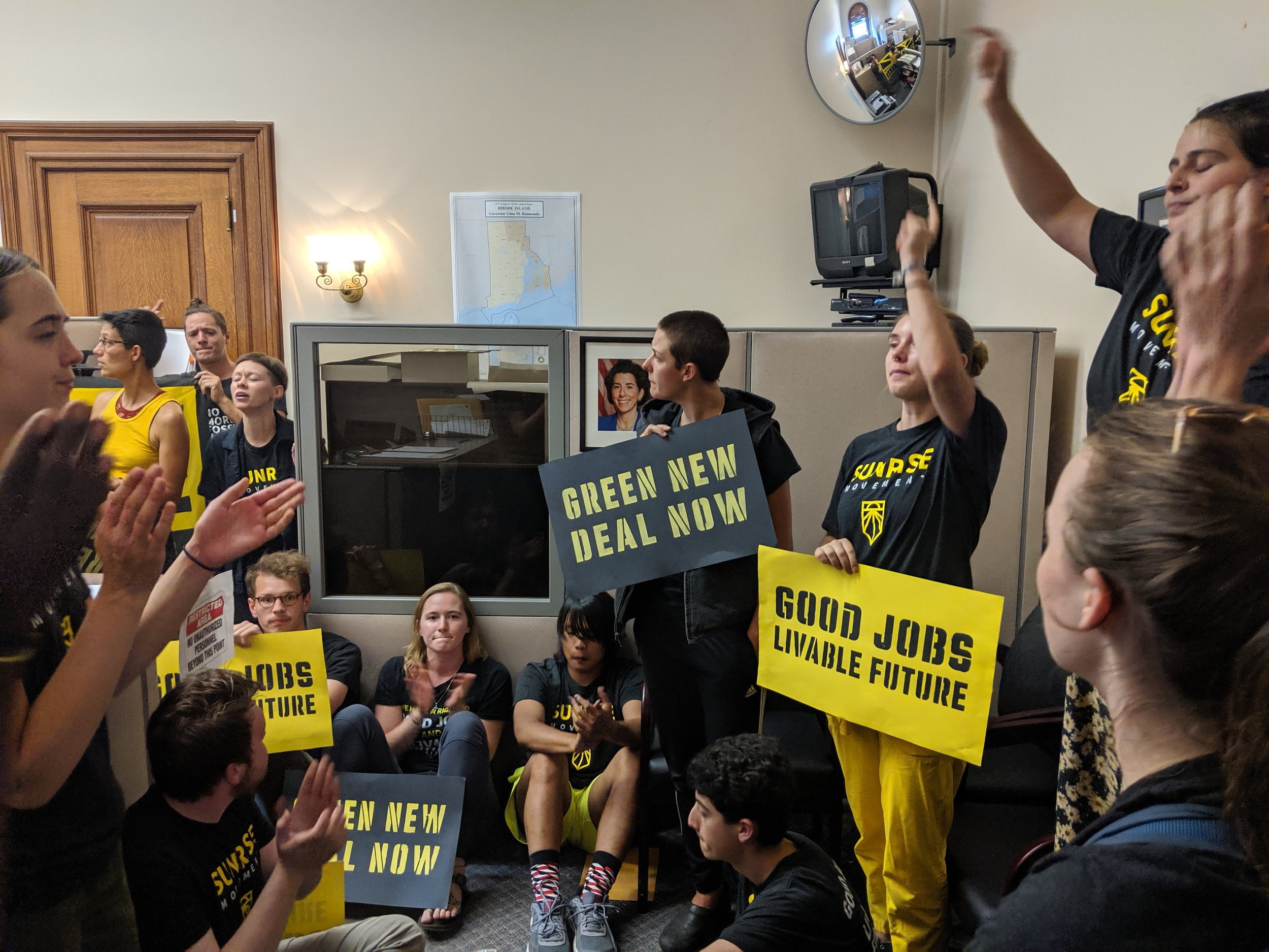 The sit-in at an administrative office of Gov. Gina Raimondo.