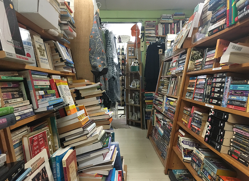 Buying used books is a great way to save money and resources. Plus, it's fun to search cluttered aisles. (Abby Bora/ecoRI News photos)