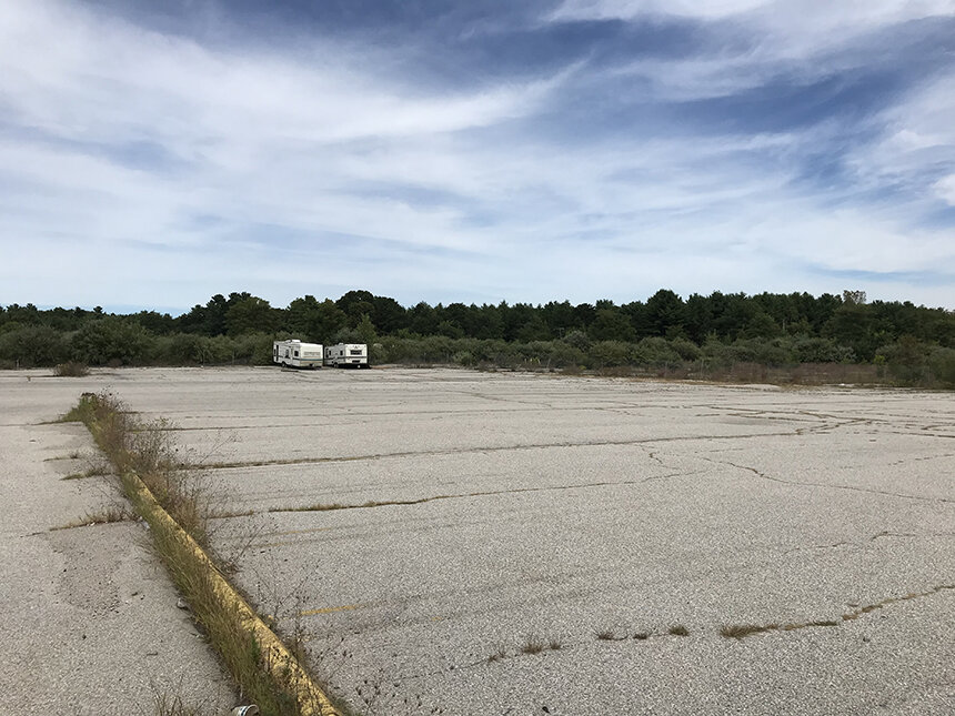 This vacant plaza on Route 3 in Coventry, which was once home to Almacs and Kmart, has been empty for about two decades. During the past few years, when forestland in residential neighborhoods was being clear-cut to make room for utility-scale renewable-energy projects, this vacant commercial space was ignored. (Frank Carini/ecoRI News)