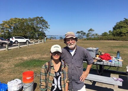 The author and a local college student Bie Khang recently spent a few hours helping to clean up Conimicut Point. (Courtesy photo)