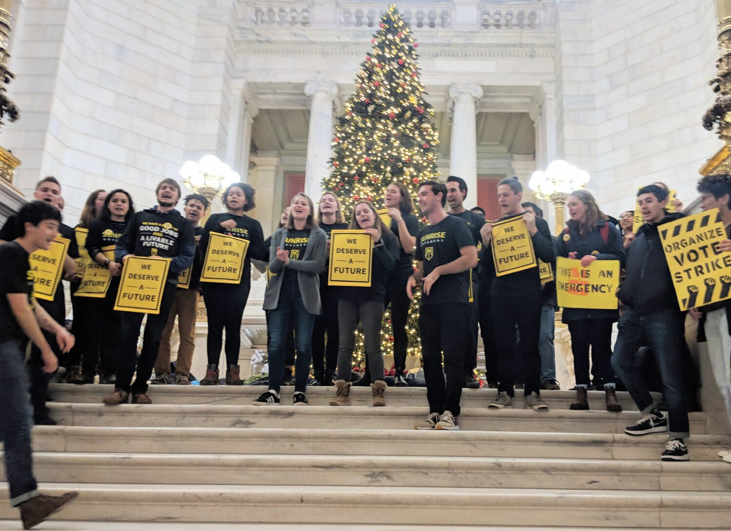 Sunrise Movement activists occupied the Statehouse rotunda prior to their arrests.