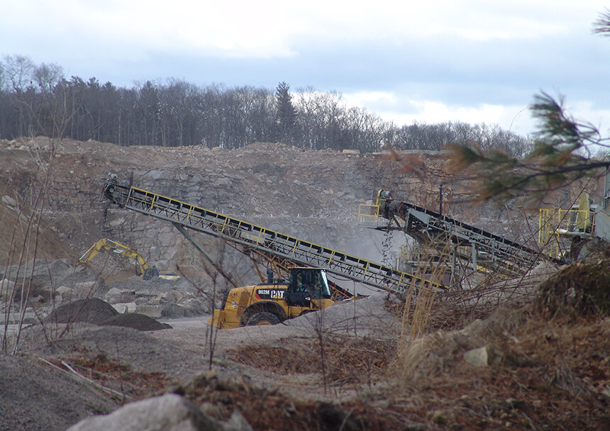 Hopkins Hill Sand & Stone, which blasts and mines next to the Big River Management Area, has been operating illegally since fall 2004. (Frank Carini/ecoRI News photos)