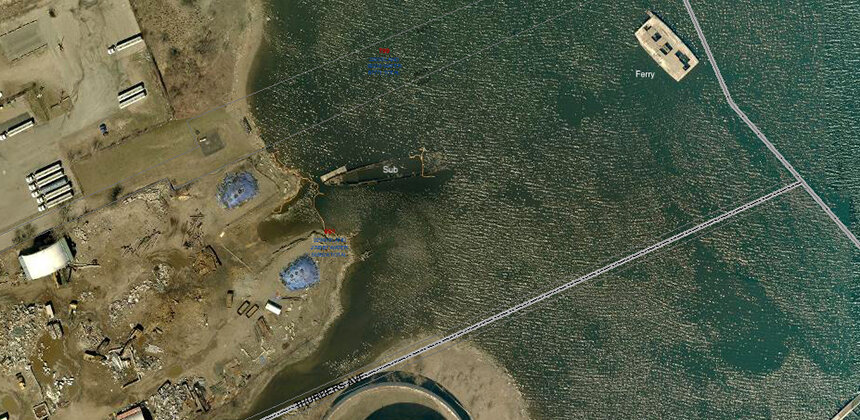 Several of Rhode Island Recycled Metals' vessels are sunk or partial submerged in the Providence River. (City of Providence GIS)