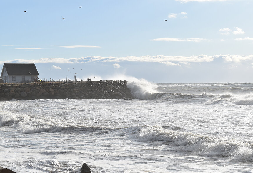 The relentless force of the sea is a venerable foe for human-made structures, such as this seawall at South Kingstown Town Beach. (Frank Carini/ecoRI News staff)