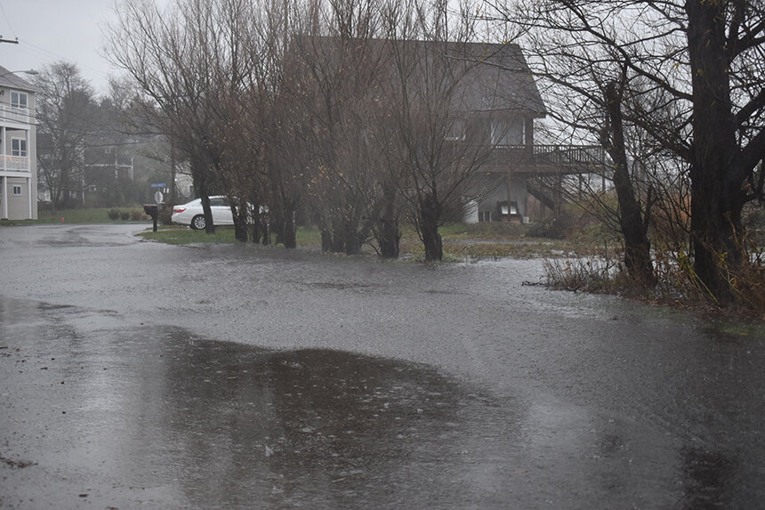 More intense and frequent rains, combined with stronger storm surge and a rising sea level, are routinely flooding coastal areas, such as the Common Fence Point neighborhood in Portsmouth. (Frank Carini/ecoRI News)