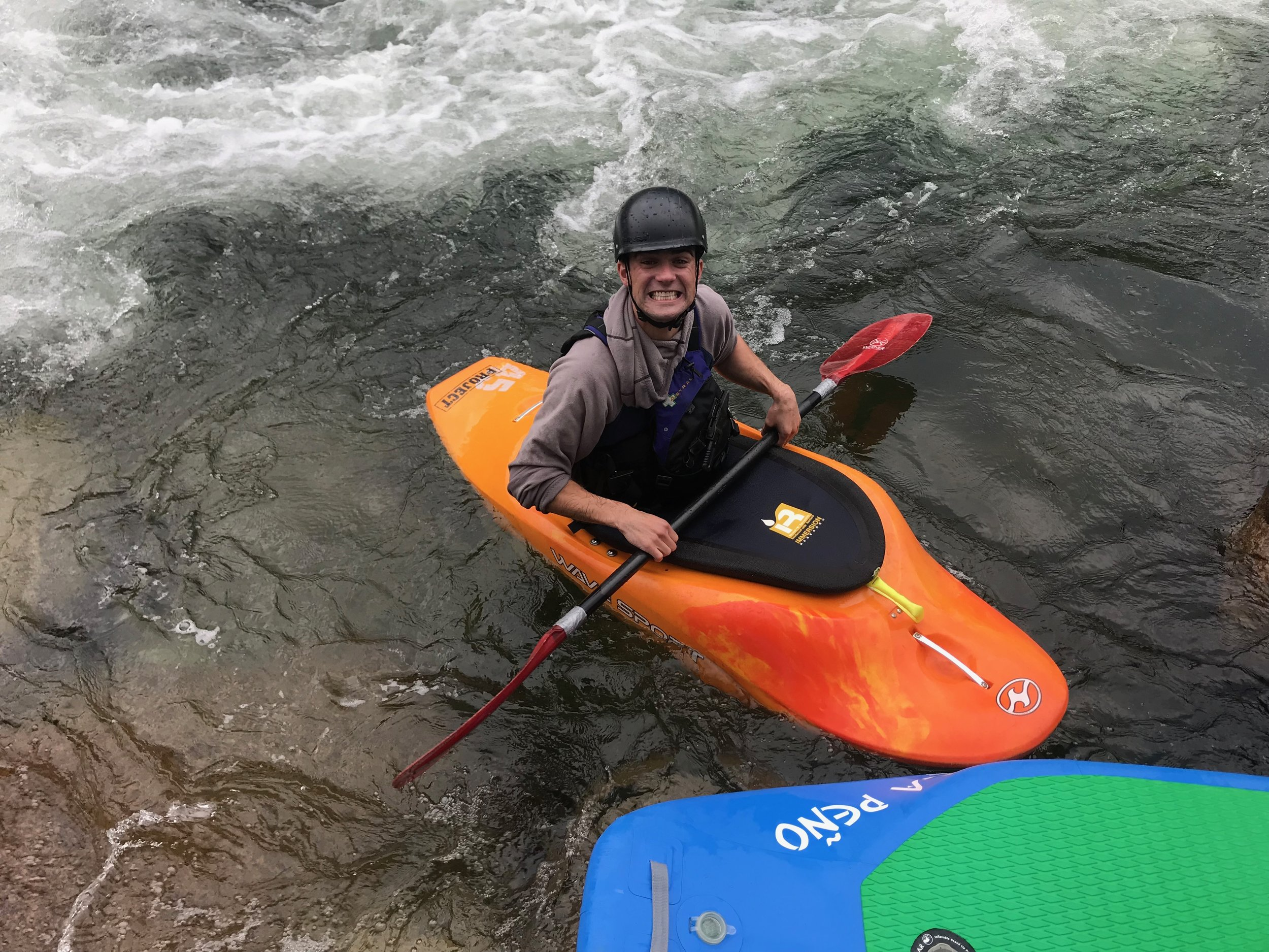 Fletcher is all smiles after taking his kayak for a spin on the wave.
