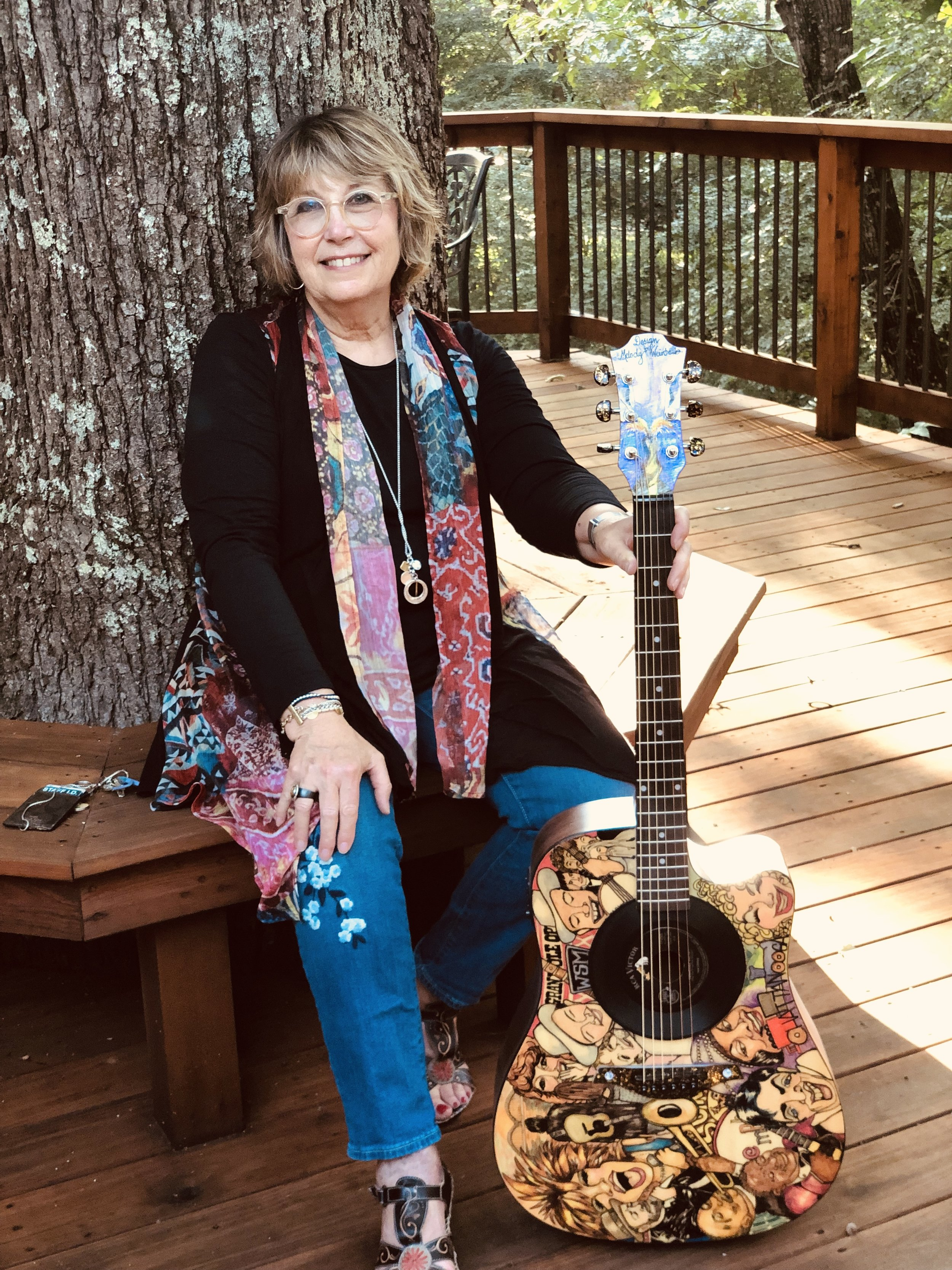 """Melody Weintraub with her art guitar, """"Tennessee Sounds."""" 2019. DO NOT USE WITHOUT PERMISSION."""