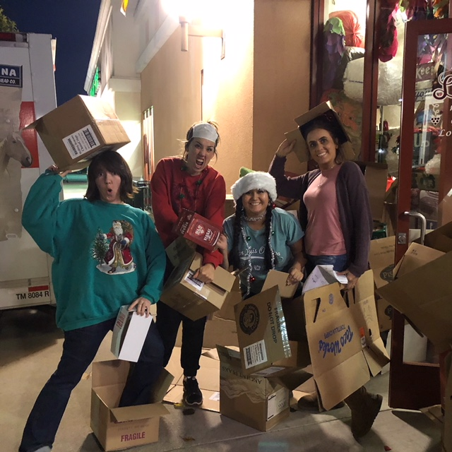 Our christmas elves breaking down our mountain of boxes!