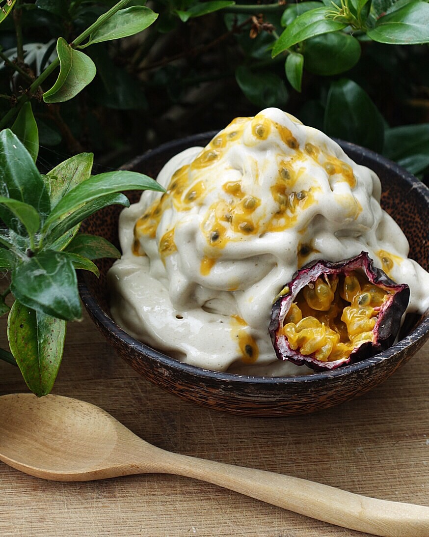 A simple yet delicious bowl of plain banana icecream topped with fresh passionfruit.