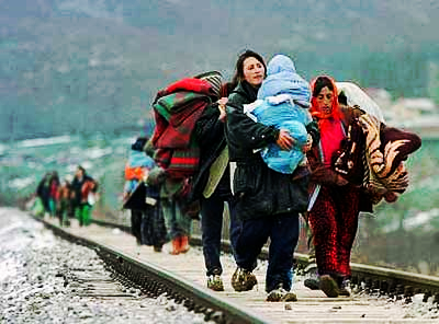 Refugees walk along railways attempting to leave Greece.