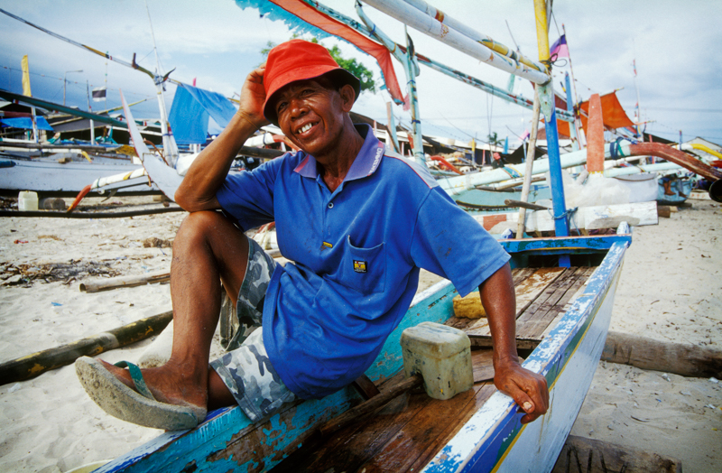 A photo I took in Jimbaran Bay, Bali. Strolling the beach, my husband wanted to check out the boats. I had no interest in boats so found people to chat with. This man seemed very proud to have his photograph taken.