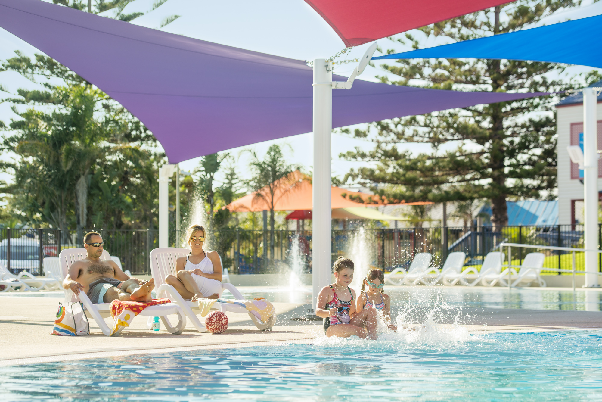 A photograph I took recently for Adelaide Shores of their new pool area. On shoot, I interacted with 'mum and dad'plus the two children to get the look we were after. Three different families, none had ever met each other before. None with modeling experience. I think they did well.In retouching, I had to add blue sky, lighten bodies, remove distractions etc along with all the usual adjustments ensuring colour, contrast and horizon line are all correct.