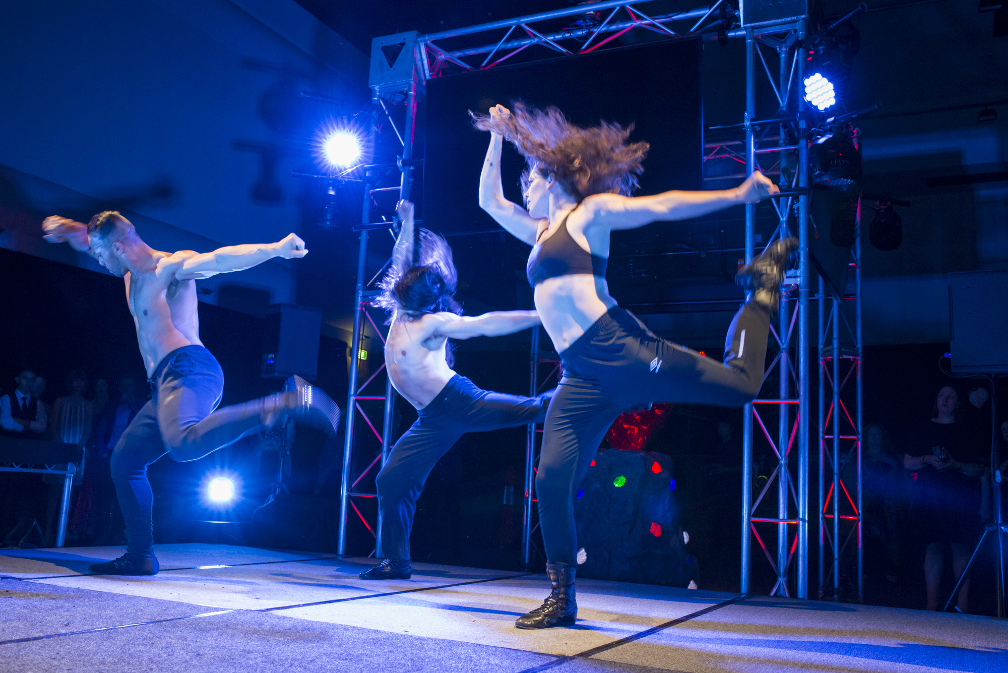 A little fill has made some parts of the dancers bodies sharp while still retaining movement to show the speed, move and vitality.