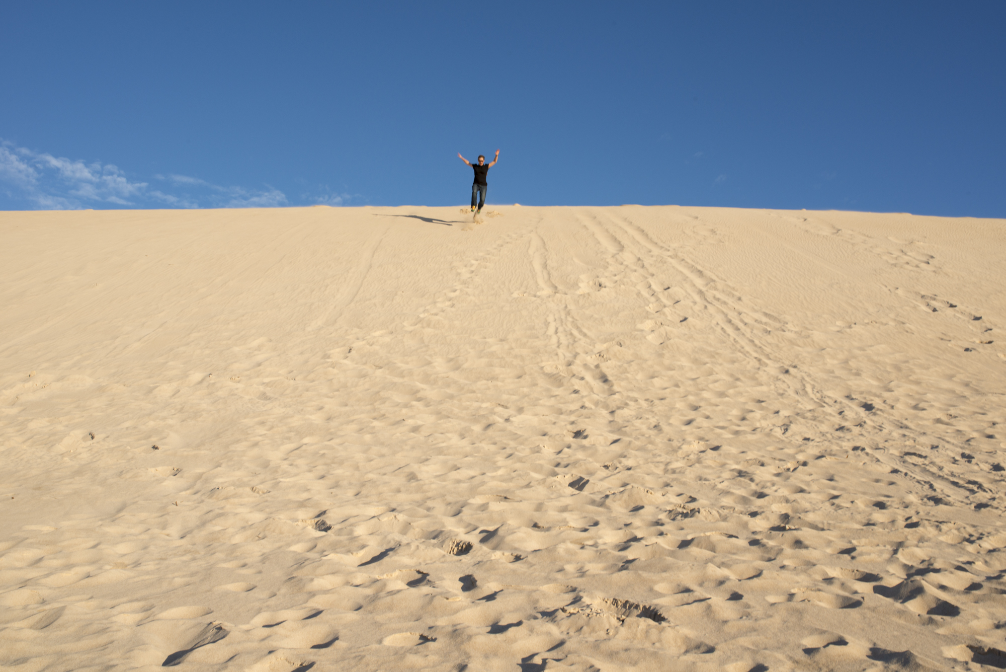 Don't let the legs get away from you... running down Little Sahara dunes.