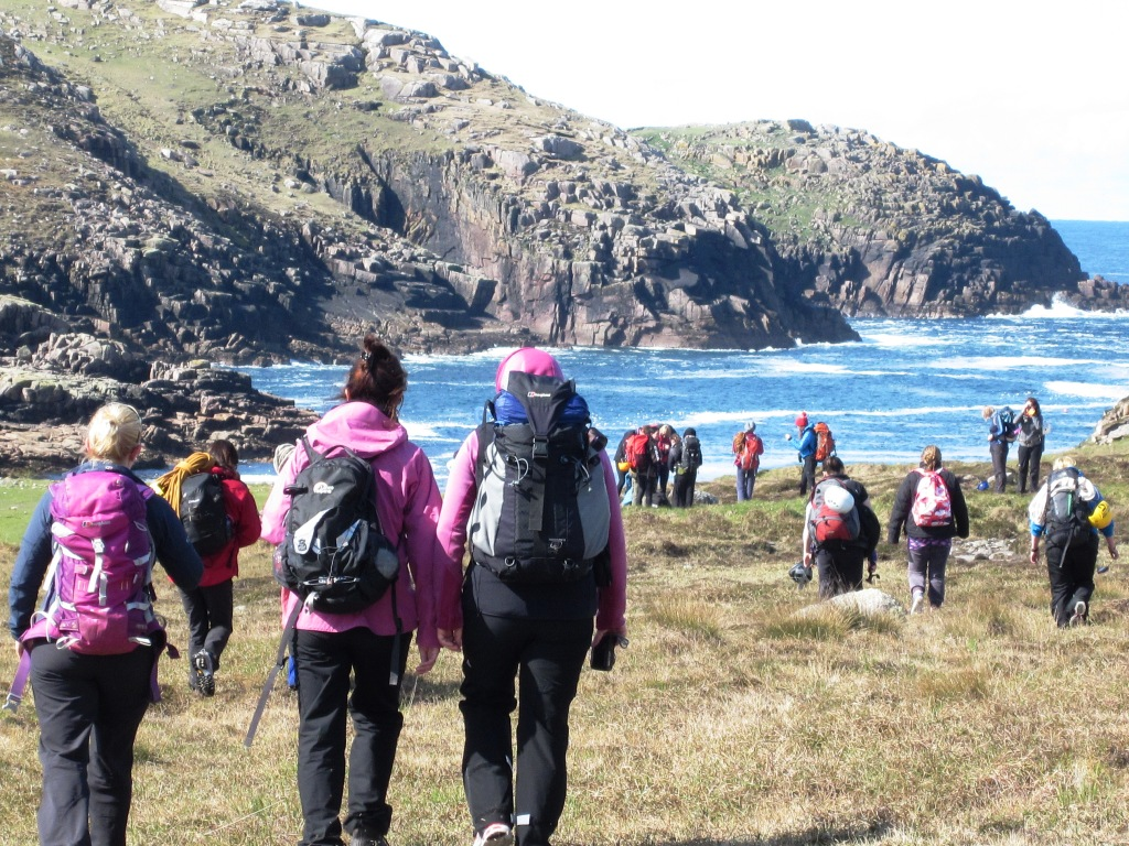 Climbers on their way to the crag Gola Island.jpg