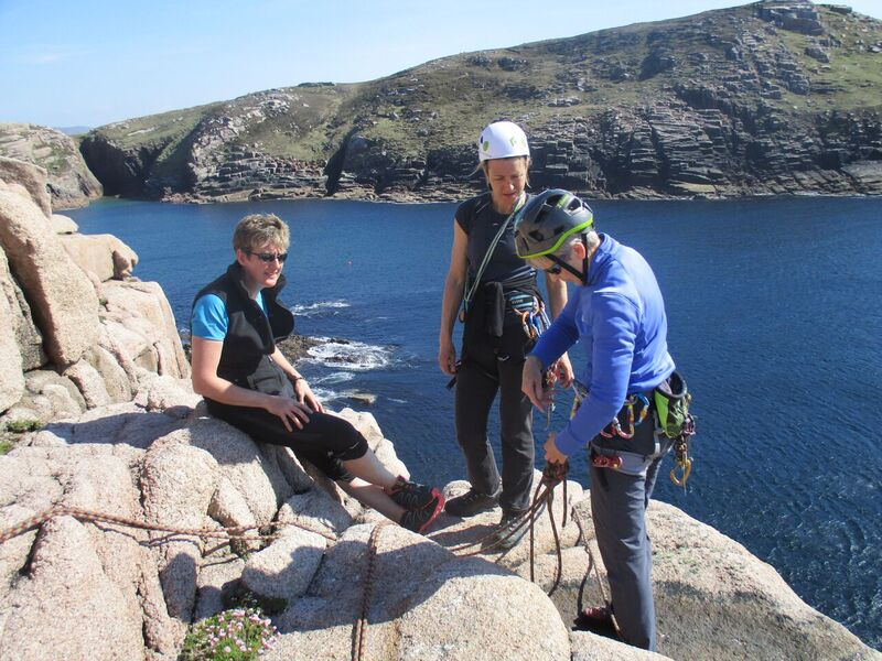 Gola climbers – Ursula Timmins (Waterford), Briar Harvey (UK) and Colette Mahon (Wexford) sorting out their ropework at the top of a climb on Gola Island, photo Sylvia Kehoe (Wexford)..jpg