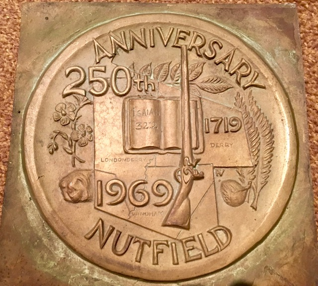 Pantograph plate of the commemorative medal from the Nutfield 250th Anniversary. It was designed by Mrs. Patricia Verani of Londonderry, and struck by the Robbins Company of Attleboro, Mass. Each town—Derry, Londonderry, and Windham—had its own design on the other side. (Courtesy of the  Derry Museum of History ; donated to the Museum by Mrs. Diana Duval in loving memory of her husband Vernon Duval, who handled the entire coinage process for the 250th anniversary committee.)