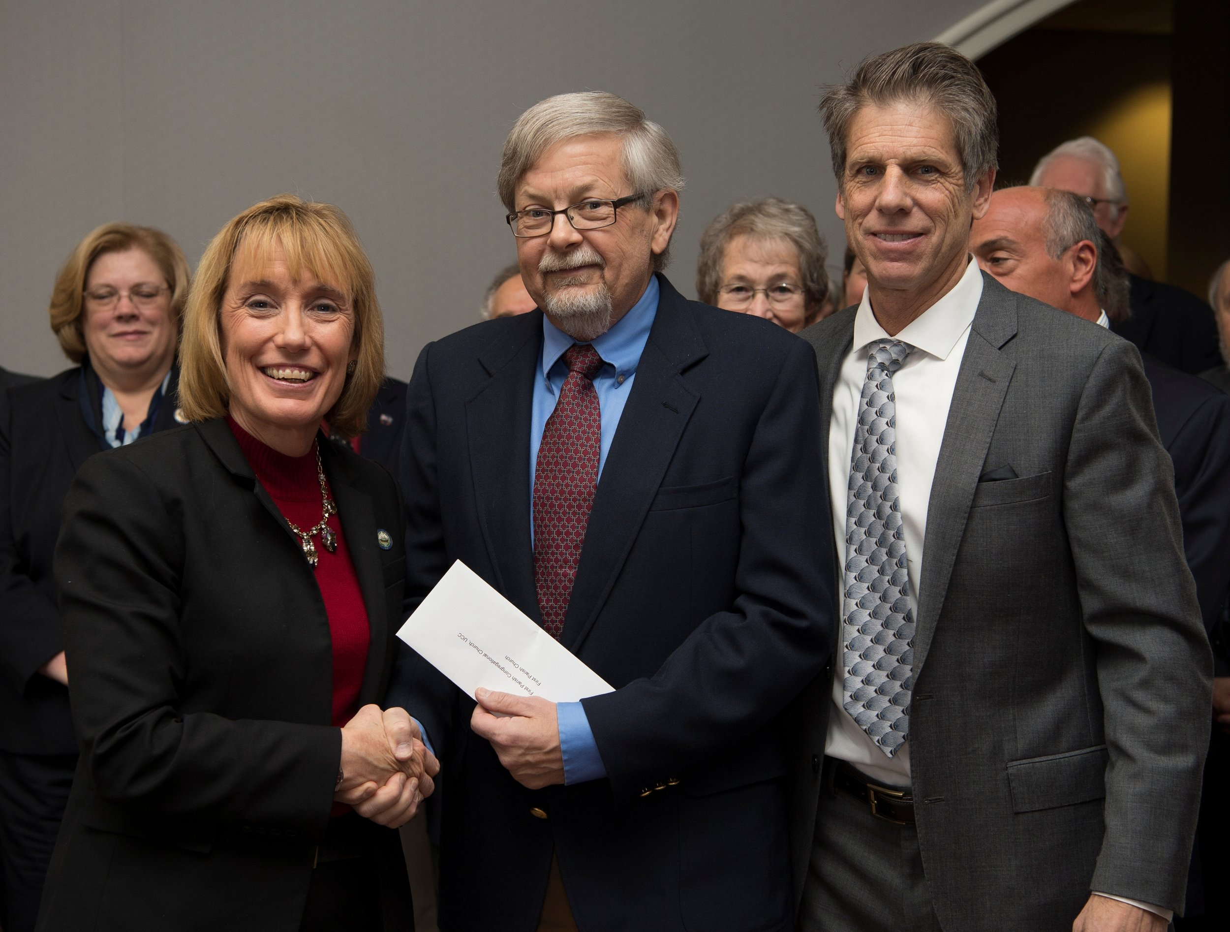 Governor Hassan and LCHIP Board Chair Doug Cole present the $59,000 grant award to Paul Lindemann on behalf of First Parish Church.  (Photo credit: Perry Smith)