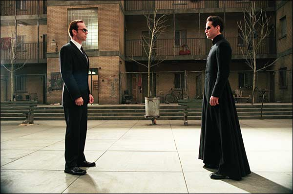 Neo: Do you ever feel like the world we live in is- Agent Smith: Hello! Would you care for some free chili cheese dogs and beer? Neo: WHOA! Hell Ya! Thanks! What was I talking about again? Agent Smith: Doesn't matter. Look, Big Bang Theory is on. Neo: Oh sweet, Bazinga!