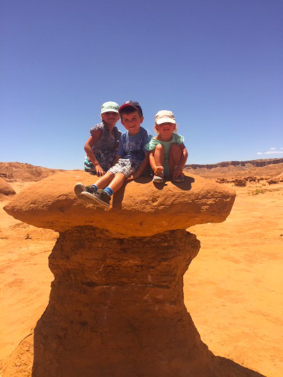 Three of my kids playing around on the hoodoos in Goblin Valley State Park, Utah.