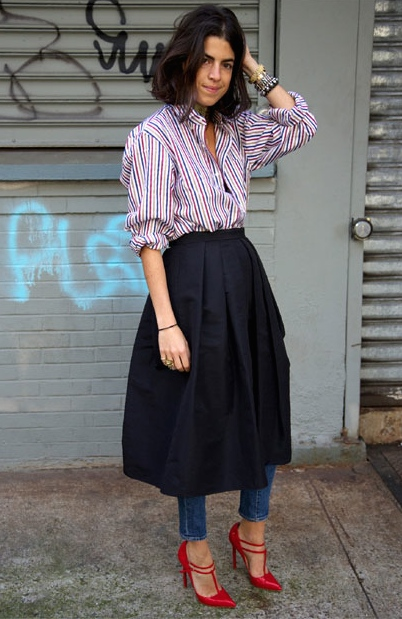 MENSWEAR is another significant trend. This model rocks menswear in a funky way hiding her skinny jeans under her woolen skirt. Note the menswear striped shirt and the unexpected red stilettos. You love MENSWEAR, but you're not that funky? Then try this look without the addition of the skirt.