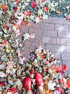 Playing in the leaves wearing my favorite red shoes...