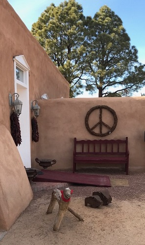 Peace from New Mexico. Notice the wooden lamb wearing a red scarf.
