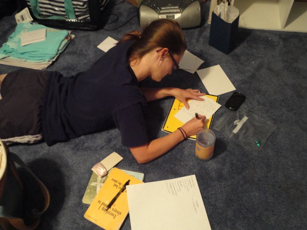 Me the night before our wedding writing letters to my bridesmaids and trying to finish my vows! :)