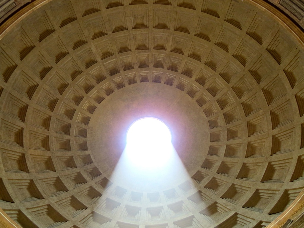 THE CEILING OF THE PANTHEON IN ROME, CAPTURED WITH A SHAFT OF LIGHT SHINING THROUGH THE OPENING