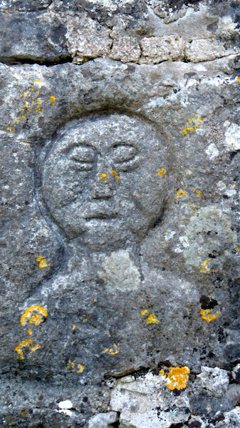 Stone carving near a sacred well in Ballyvaughan, County Clare, Ireland