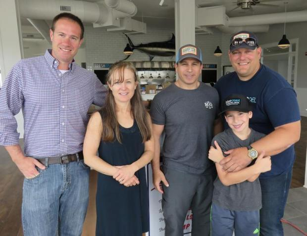 A rare quiet moment at Bluecoast Rehoboth with (l-r) SoDel Concepts Director of Operations Matt Patton, Marketing/PR guru Nelia Dolan, SoDel Concepts longtime counsel Bryan Mintz, Bryan's son Michael, and SoDel Concepts CEO/President Scott Kammerer. BOB YESBEK PHOTO