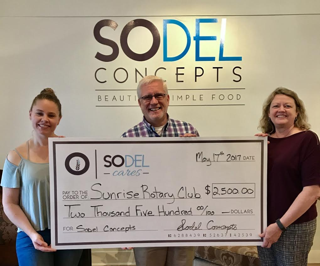 SoDel Cares, the philanthropic arm of SoDel Concepts, a hospitality group with 10 restaurants, recently donated $2,500 to Rehoboth Beach Sunrise Rotary Club. Lindsey Barry (left), the controller for SoDel Concepts, presents the check to rotary members Ray Bryant and Donna Winegar.