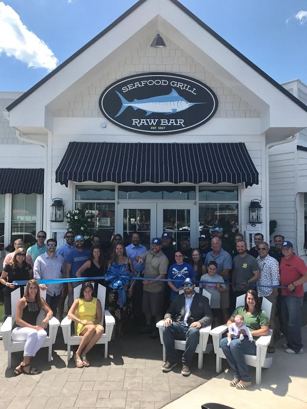 The Rehoboth Beach-Dewey Beach Chamber of Commerce welcomed Bluecoast Seafood Grill & Raw Bar to the resort community with a ribbon cutting June 26th.