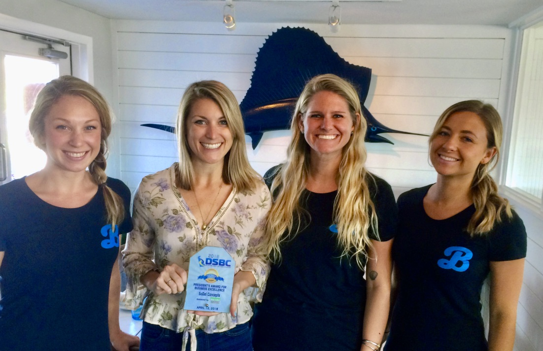 PHOTO: SoDel Concepts recently received the President's Award for Business Excellence from the Delaware Small Business Chamber. Shown with the award at Bluecoast Seafood Grill + Raw Bar in Bethany Beach is (L. to R.) Chelsea Brown, server; Jess Braun, general manager; Lauren Larson, bar manager; and Sarah Shoemaker, server.