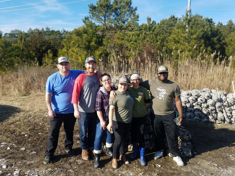 Bagging oyster shells as part of the Delaware Center for the Inland Bays' Don't Chuck your Shucks program are Matt's Fish Camp employees (l-r) Dave Inman, Jack Temple, Lorena Torres, Zulma Barahona, Mayra Roork and T.J. Mack.