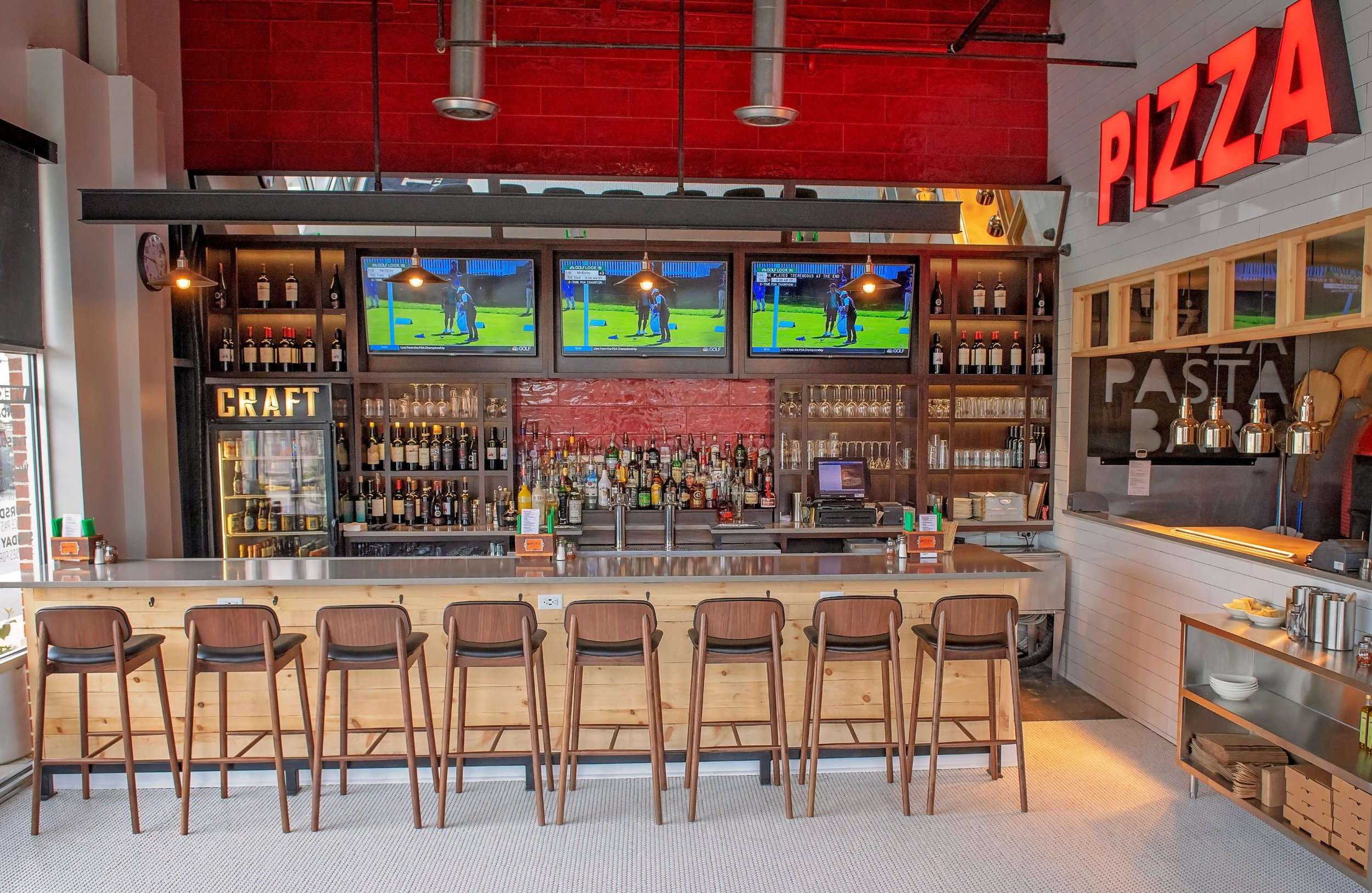 Crust & Craft in Rehoboth Beach recently underwent renovations that include new lighting, tables, artwork and tile. The bar area in Crust & Craft sports a new quartz countertop and barstools with leather seats. [PHOTO PROVIDED]