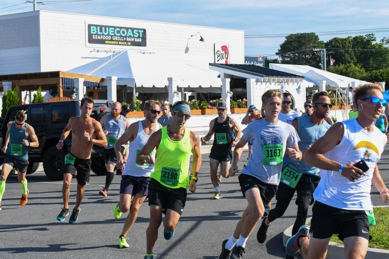 Runners round the bend at the start of SoDel Cares 5k. DAVE FREDRICK PHOTOS