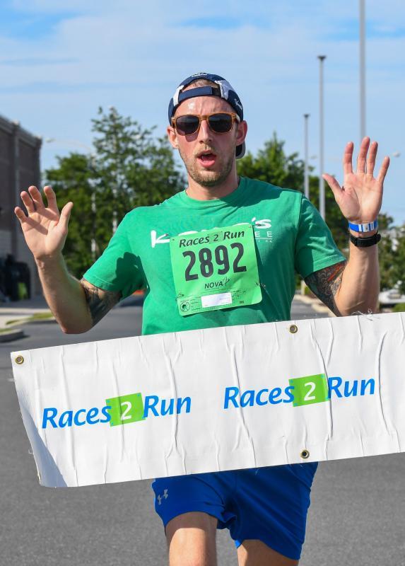 Matt Latimer wins the race in a time of 17:53.