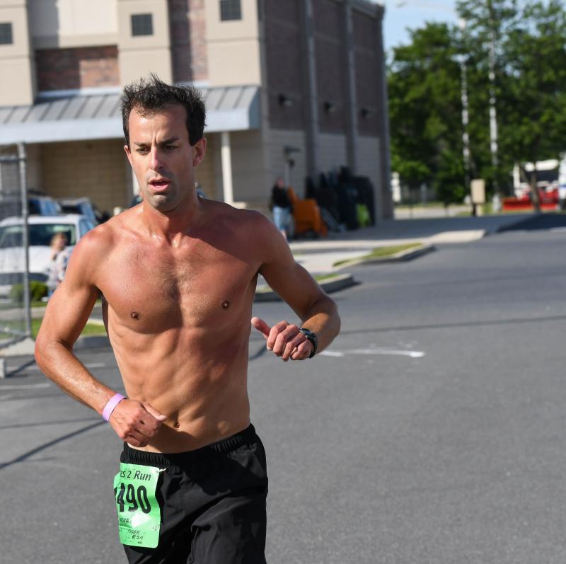 Bryan Mack crosses the finish line in 19:19.