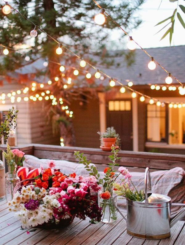 Christmas Lights   The warm glow that Christmas lights bring shouldn't be stored away for the winter. Hang Christmas lights or clear globe lights on your patio, around your pool, and in your trees. You'll be amazed how a small amount of lighting will make you fall in love with your backyard.