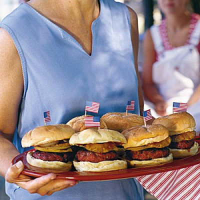 Burgers   Burgers are always a good idea. Put a twist on the classic burger by using a sweet and savory burger recipe which includes grilled pineapple, chili sauce, and sweet onions.  Top them with American Flag pennants and you're all set!