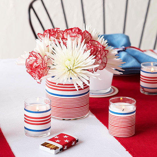 Patriotic Candles and Flowers   Wrap your candle holders and flower vases in patriotic paper to create easy and festive table centerpieces.