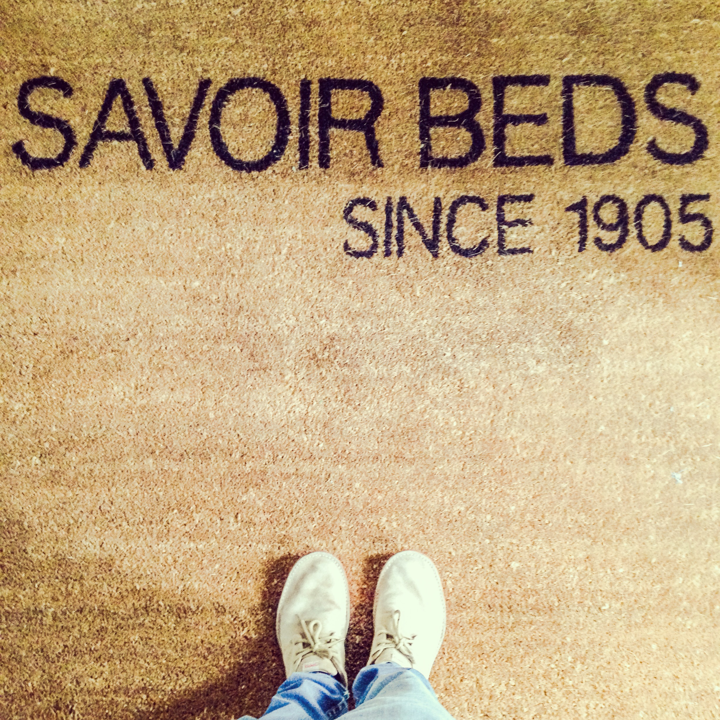 Standing at the entrance to Savoir Beds Park Royal London factory.