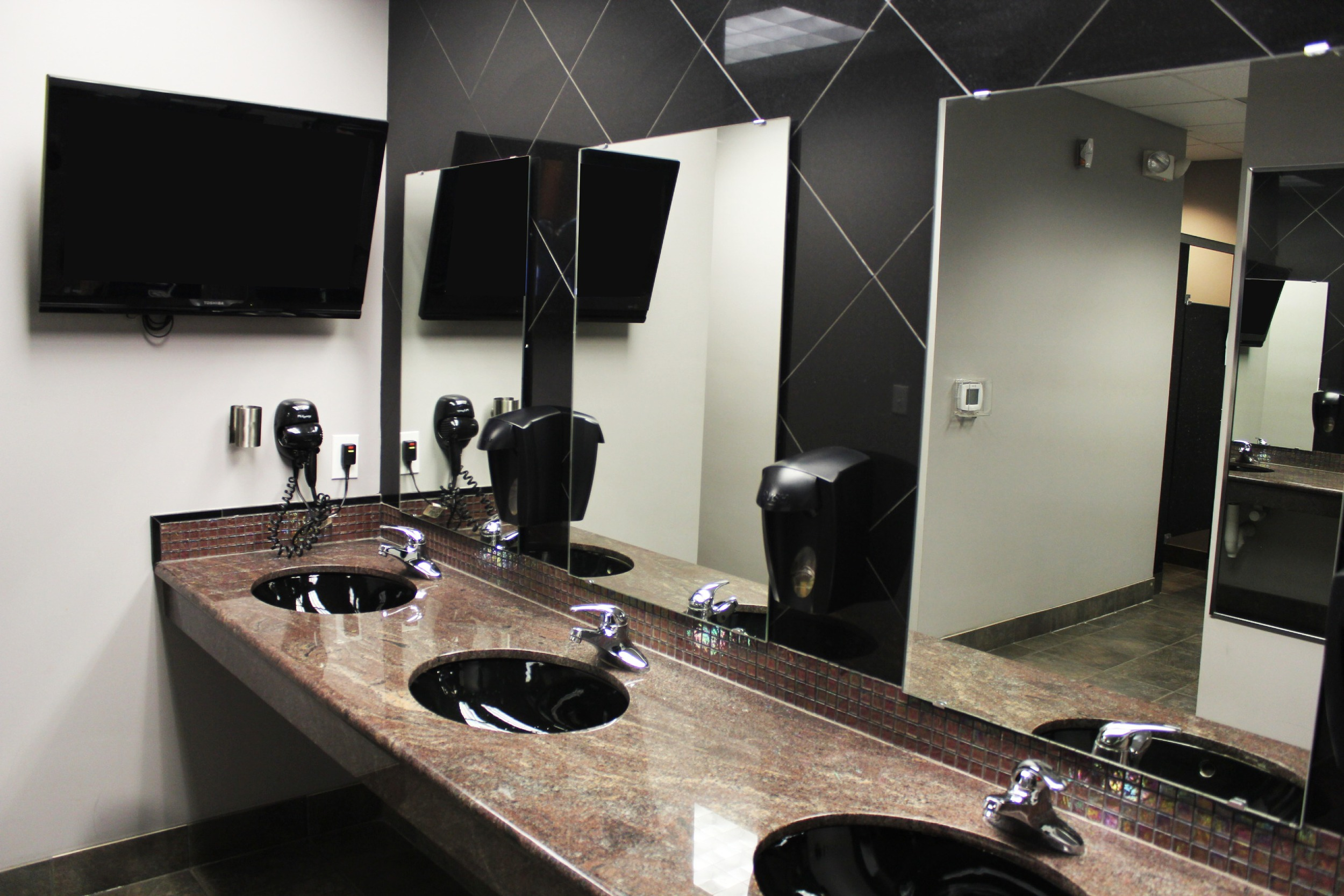 Women's Locker Room  - showers with shampoo, body wash, and conditioner and a sauna