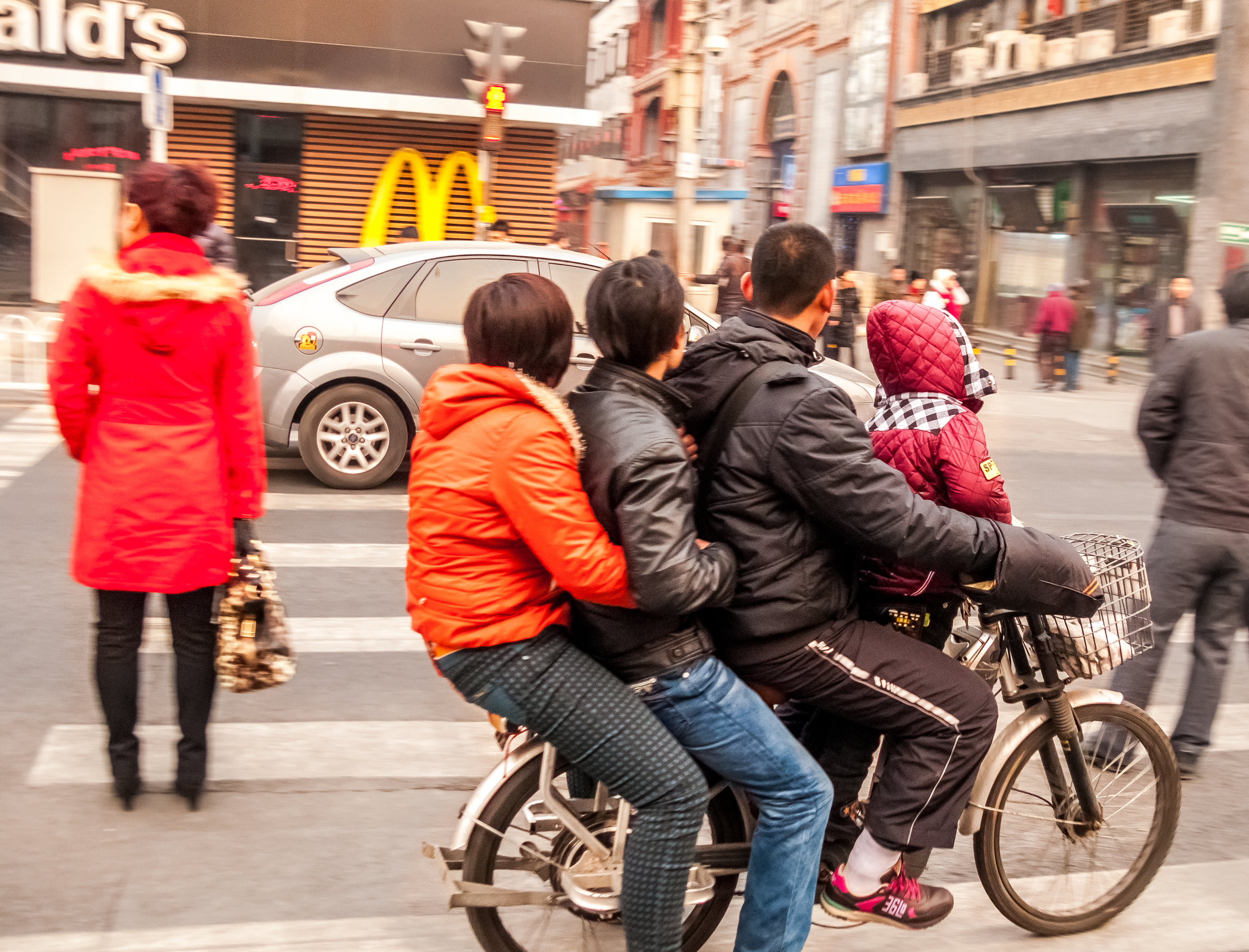 A moped made for 4 . China.