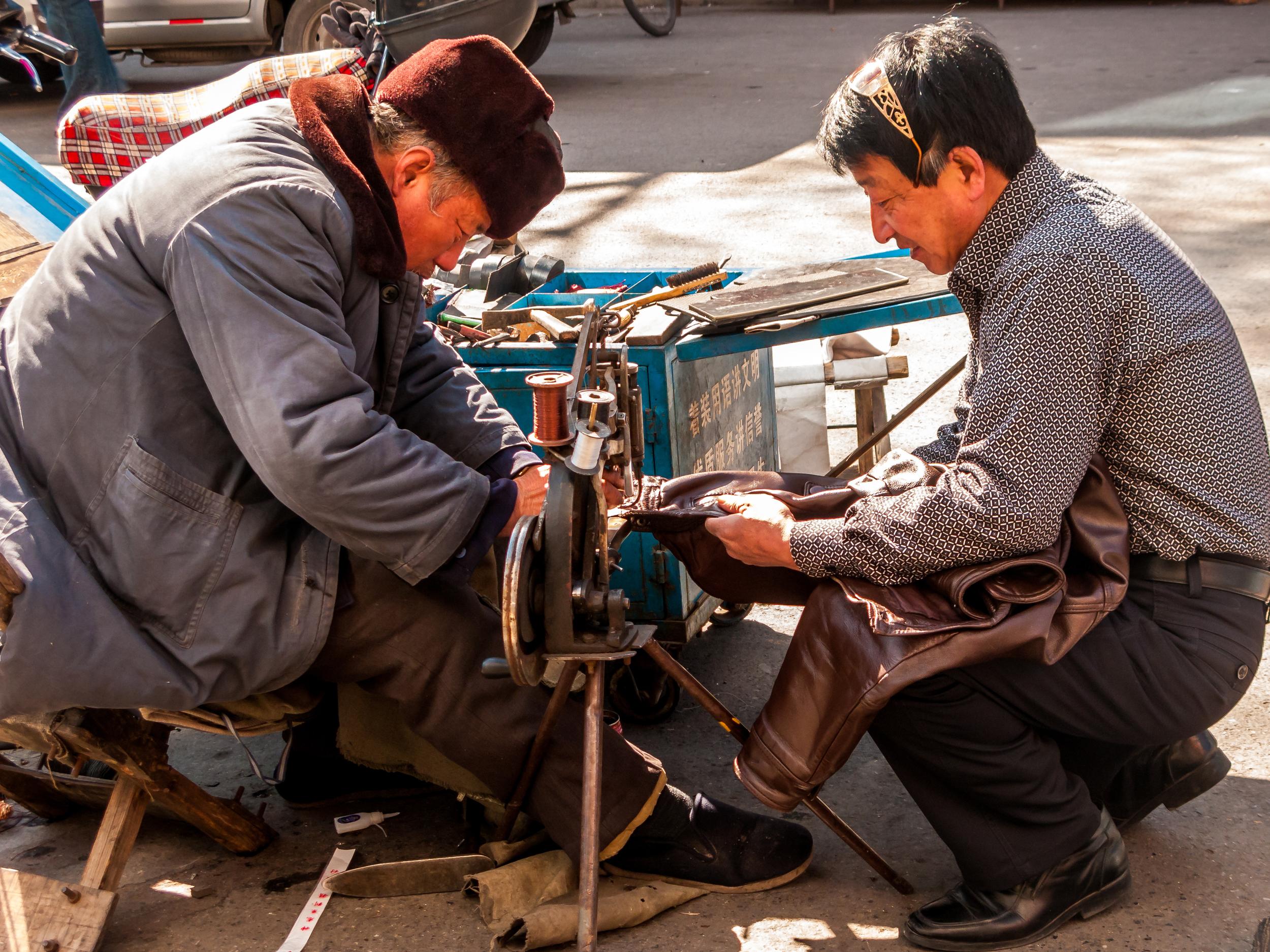 Street repairs, China.