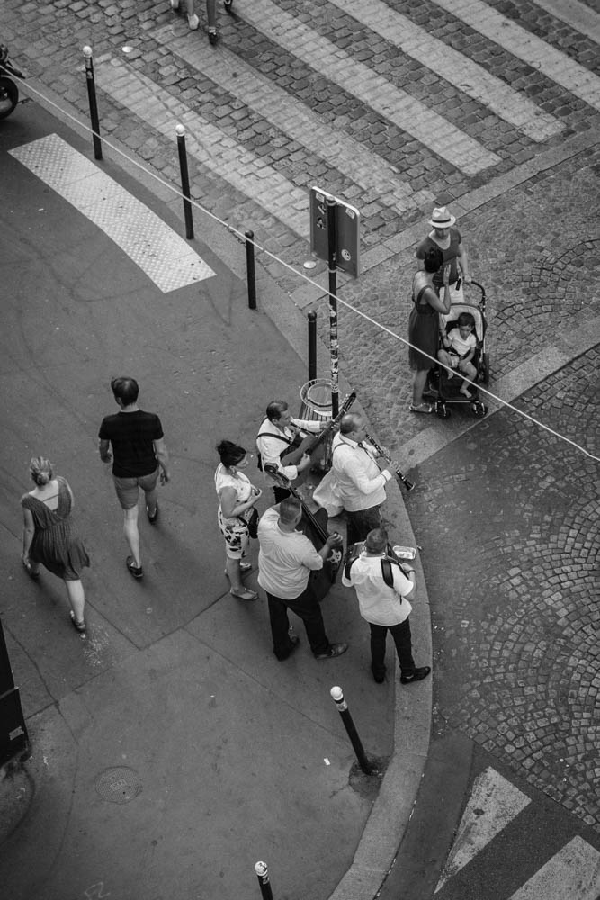A trip to Paris,France, staying in an apartment in the Montmartre district. A very hot evening and a band on the street corner entertaining diners opposite.