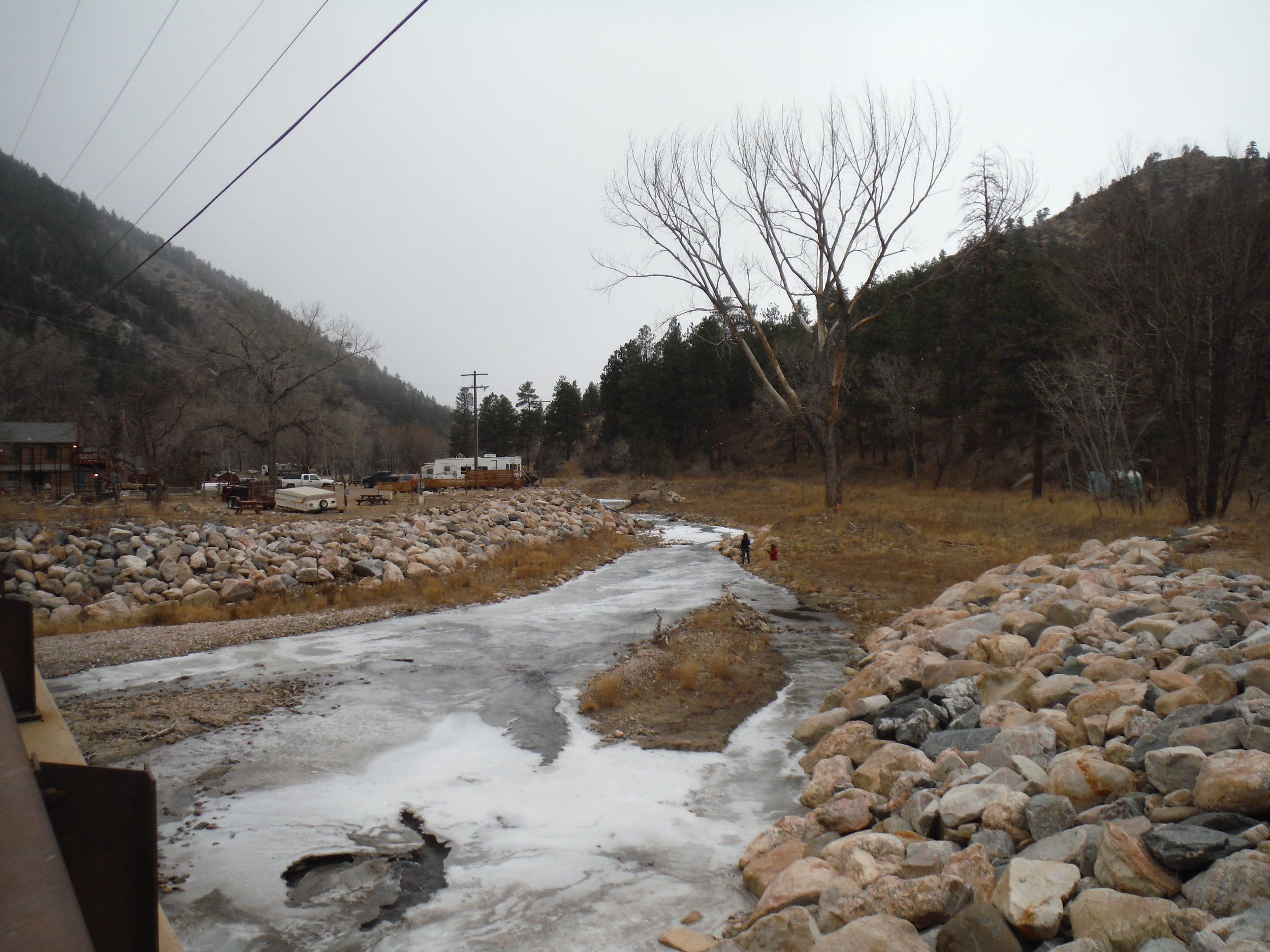 December 2016: Looking upstream at the North Fork from the US 34 bridge after emergency work was completed (December 2016). Efforts undertaken in the months following the flood to quickly protect damaged structures from a large spring runoff resulted in a channelized ditch with riprap on both sides. The emergency repairs may have provided some emotional comfort but offered very little long-term relief and even less ecological benefit.