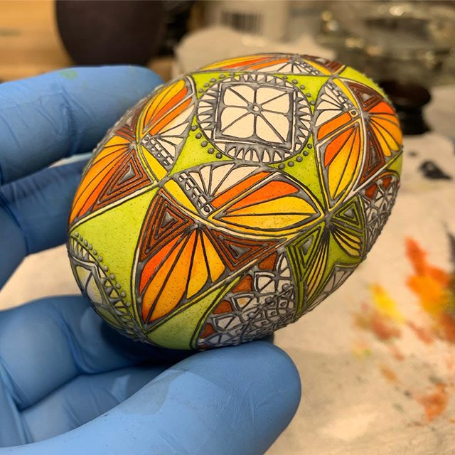 a #workinprogress #batikeggsbymark #pysanky #pisanki #batik #goose #egg #eggart #butterflies #circles #squares #fallcolors #orange #yellow #brown #cle #clevelandartist